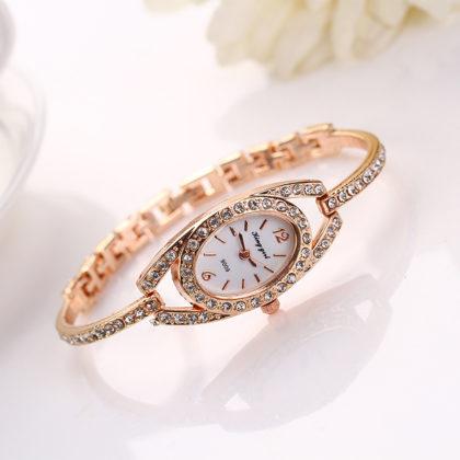 Ceas elegant auriu incastrat cu cristale profil