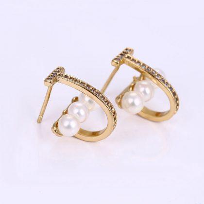 Cercei placati aur cu perle si cristale profil