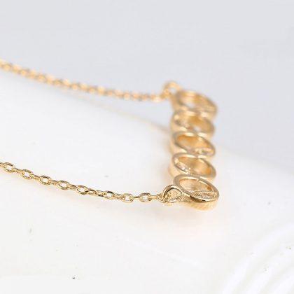 Colier elegant cercuri placat aur cu cristale profil