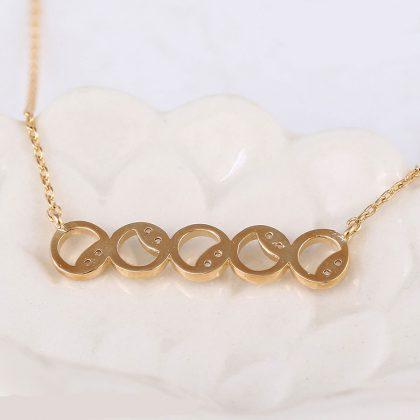Colier elegant cercuri placat aur cu cristale spate