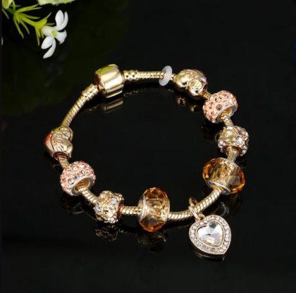 Bratara charm placata aur cristale aurii fata