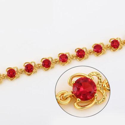 Bratara eleganta placata aur cristale rosii sus
